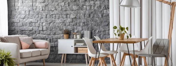 Kamień na ścianie w salonie w stylu skandynawskim