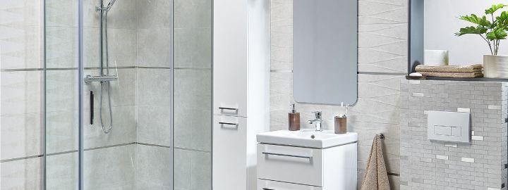 Szara łazienka z narożną kabiną