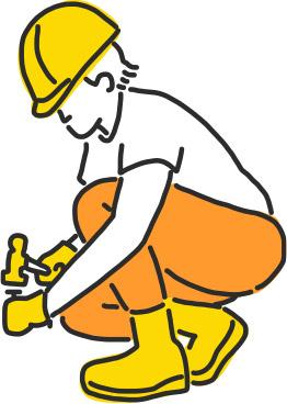 Pracownik budowlany wbija gwoździe